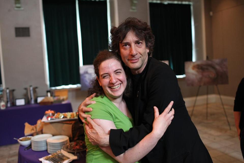"Charlie Mahoney for The Boston Globe. ""Gillian Daniels poses with author Neil Gaiman prior to his reading at the Multicultural Arts Center."""